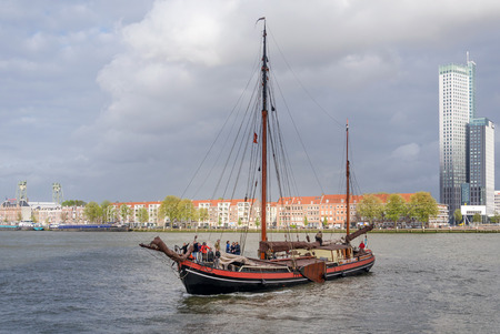 maas: Rotterdam, Netherlands - May 9, 2015: Tourist boat on Nieuwe Maas (New Meuse) river in Rotterdam, Netherlands. The port of Rotterdam is the largest cargo port in Europe and the 10th largest in the world.