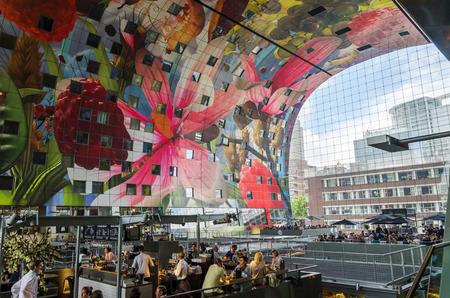 Rotterdam, Netherlands - May 9, 2015: Retail Shop in Markthal (Market hall) a new icon in Rotterdam. The covered food market and housing development shaped like a giant arch by Dutch architects MVRDV.