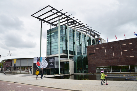 museum visit: Rotterdam, Netherlands - May 9, 2015: People visit Het Nieuwe Institut museum on May 9, 2015 in Rotterdam, Netherlands. This museum is a cultural institute for architecture and urban development.