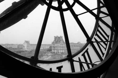 Large clocks with roman numerals in Museum dOrsay to Musee du Louvre in Paris, France (Black and White)