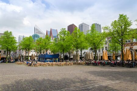 plein: The Hague, Netherlands - May 8, 2015: People at Het Plein in The Hagues city centre, with the statue of William the Silent in the middle. on May 8, 2015.