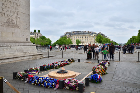 tomb of the unknown soldier: Paris, France - May 14, 2015: Tourist visit Tomb of the Unknown Soldier beneath the Arc de Triomphe, Paris. on May 14, 2015.