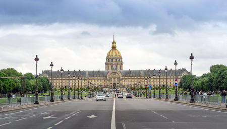invalides: Paris, France - May 14, 2015: Tourist visit The Army Museum (Musee de larmee) in Paris, France. The museums seven main spaces and departments contain collections that span the period from antiquity through the 20th century.