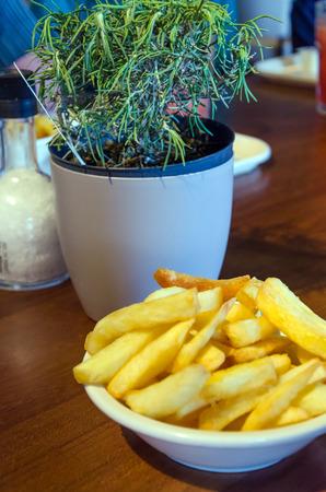 potato fries: Dutch potato fries on wood table Stock Photo