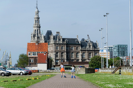 pilotage: Antwerp, Belgium - May 11, 2015: Children roller skating against pilotage building in Antwerp, Belgium. It is the most populous city in Belgium with a population of 510,610.