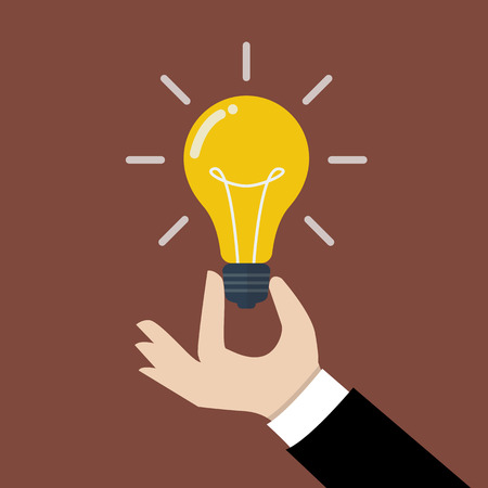 bright light: Hand holding light bulb. Business idea concept.