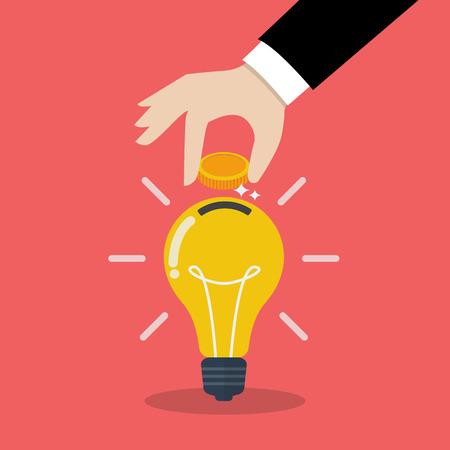Hand inserting coin in light bulb. Smart investmen Concept