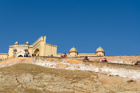amber fort: Jaipur, India - December 29, 2014: Tourists enjoy elephant ride in the Amber Fort on December 29, 2014, Amber Fort was built by Raja Man Singh I  in Jaipur, Rajasthan, India.