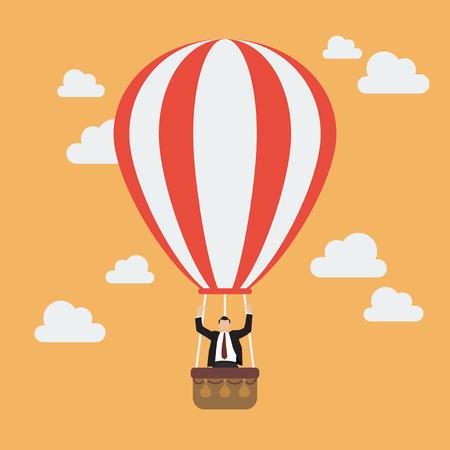 air balloon: Businessman celebrating in hot air balloon