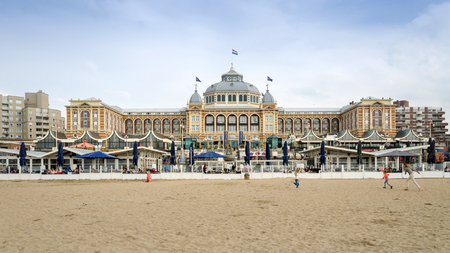 scheveningen: The Hague, Netherlands - May 8, 2015: Tourists at Kurhaus of Scheveningen, The Hague in the Netherlands is a hotel which is called the Grand Hotel Amrath Kurhaus The Hague since October 2014. It is located in the main seaside resort area, near the beach Editorial