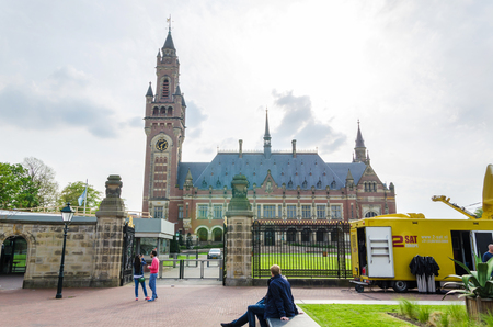 international law: The Hague, Netherlands - May 8, 2015: Reporters at The Peace Palace in The Hague, Netherlands. It is often called the seat of international law because it houses the International Court of Justice.