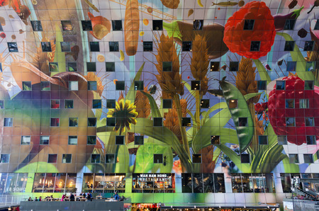 culinary tourism: Rotterdam, Netherlands - May 9, 2015: People shopping at Markthal (Market hall) a new icon in Rotterdam. The covered food market and housing development shaped like a giant arch by Dutch architects MVRDV. Editorial