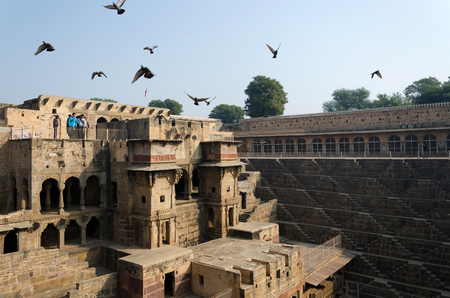 dausa: Jaipur, India - December 30, 2014: Tourist visit Chand Baori Stepwell, Jaipur, Rajasthan, India on December 30, 2014.  It was built by King Chanda of the Nikumbha Dynasty between 800 and 900 AD