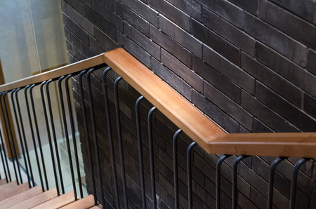 upraise: Wooden handrail with brick wall background