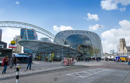 housing development: Rotterdam, Netherlands - May 9, 2015: People visit Markthal (Market hall) near blaak station in Rotterdam. The covered food market and housing development shaped like a giant arch by Dutch architects MVRDV.