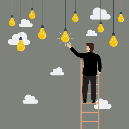 ladder: Businessman on the ladder catching a light bulb idea. Business concept