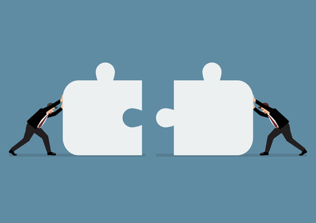 challenges: Businessmen pushing two jigsaw pieces together. Business teamwork