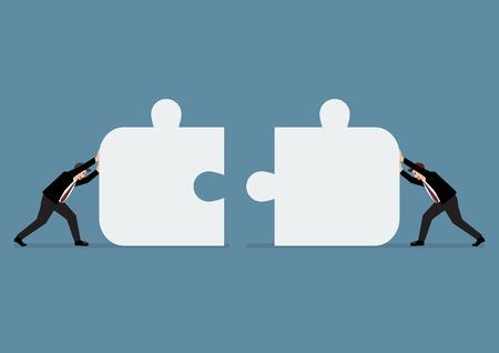 Les hommes d'affaires poussant deux pièces du puzzle ensemble. le travail d'équipe d'affaires