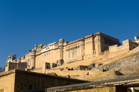 amber fort: Jaipur, India - December 29, 2014: Tourists visit Amber Fort in Jaipur, Rajasthan, India on December29, 2014. The Fort was built by Raja Man Singh I. Editorial