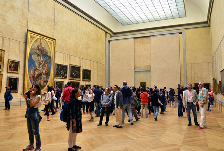 consistently: Paris, France - May 13, 2015: Visitors Louvre Museum, Paris, France. With 8.5 m annual visitors, Louvre is consistently the most visited museum worldwide.
