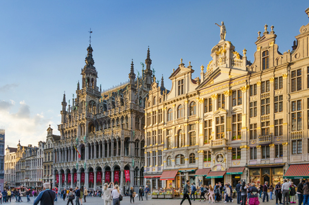 the place is important: Brussels, Belgium - May 13, 2015: Many tourists visiting famous Grand Place the central square of Brussels. The square is the most important tourist destination and most memorable landmark in Brussels. Editorial