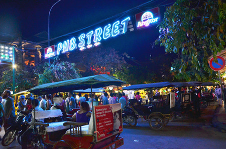 Siem Reap, Cambodia - December 2, 2015: Unidentified tourists shopping at the Pub street in Siem Reap, Cambodia. Pub street is the famous night market of Siem Reap.
