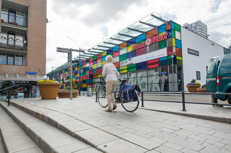 flevoland: Almere, Netherlands - May 5, 2015: People walking in Modern city center of Almere, Flevoland, the newest city in the Netherlands, where construction began in 1975.