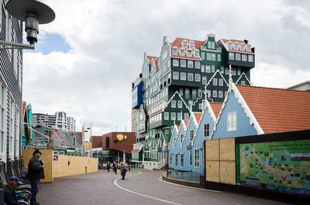 zaan: Zaandam, Netherlands - May 5, 2015: People walk on a pedestrian zone in Zaandam, Netherlands. Zaandam was a leading city in the first Industrial Revolution. Into the second half of the 20th century, Zaandam was still an important lumber port. Editorial