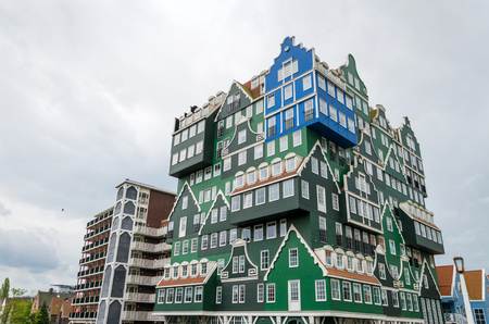 zaan: Zaandam, Netherlands - May 5, 2015: Inntel Hotels landmark in Zaandam, Netherlands. Opened in 2009, the design attracts guests by incorporating the traditional architecture of the Zaan region.