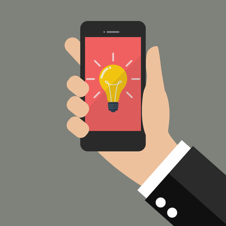 smartphone in hand: Hand holding smartphone with Light Bulb on display. Flat style design