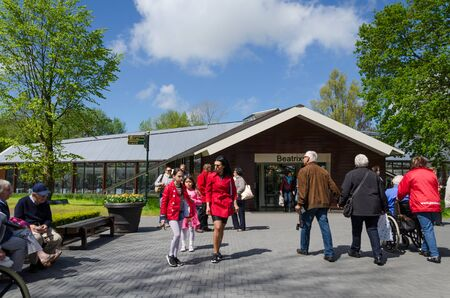 lisse: Lisse, The Netherlands - May 7, 2015: Tourists visit famous garden in Keukenhof on May 7, 2015. Keukenhof is the most beautiful spring garden in the world.