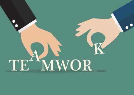 in insert: Hands insert alphabets into teamwork word. Business concept