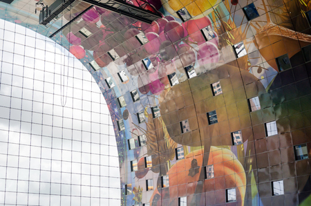 dutch landmark: Interior of Markthal (Market hall) in Rotterdam. The covered food market and housing development shaped like a giant arch. Stock Photo