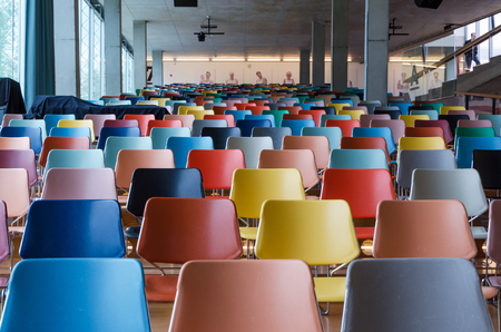 onlooker: Rows of colorful chairs in modern auditorium
