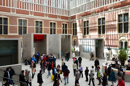 atrium: Amsterdam, Netherlands - May 6, 2015: Tourists in the modern atrium Rijksmuseum on May 6, 2015. The original interior courtyards have been redesigned to create the imposing new entrance space of the Atrium Editorial