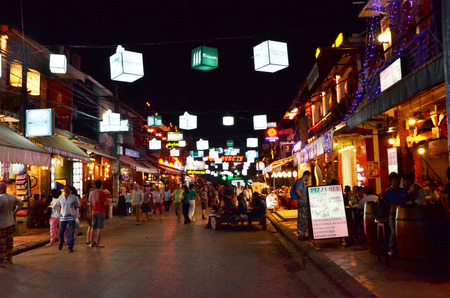 watch groups: Siem Reap, Cambodia - December 2, 2015: Unidentified tourists shopping at the Pub street in Siem Reap, Cambodia. Pub street is the famous night market of Siem Reap.