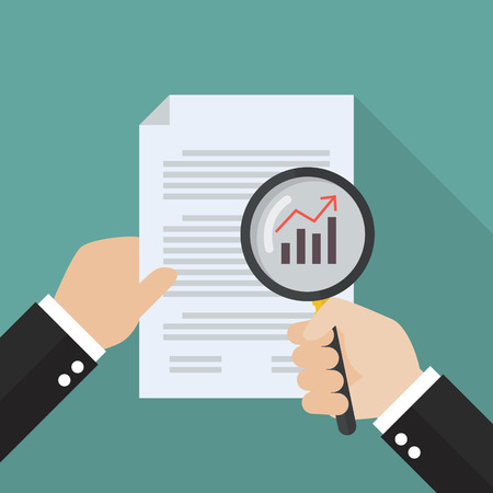 glass paper: Hand holding magnifying glass with document paper. Business analysis