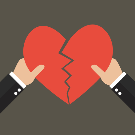apart: Hands tearing apart heart symbol. Love concept