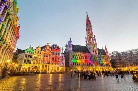 the place is important: Brussels, Belgium - May 13, 2015: Tourists visiting famous Grand Place (Grote Markt) the central square of Brussels. The square is the most important tourist destination and most memorable landmark in Brussels. Editorial