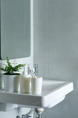 handbasin: Washbasin and mirror in a modern bathroom