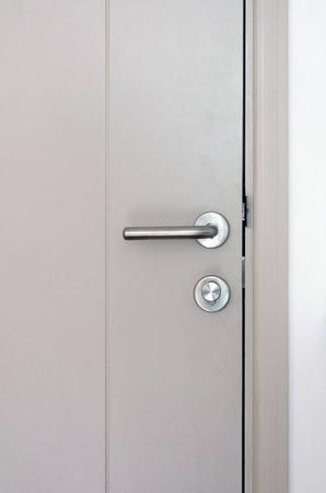 door handle: Modern style door handle and lock on grey door