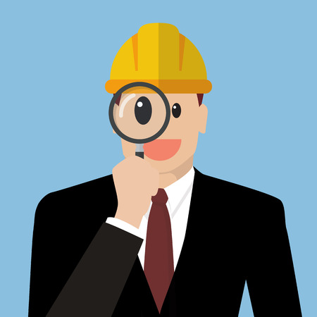 defects: Engineer looking through a magnifying glass. Defects inspection