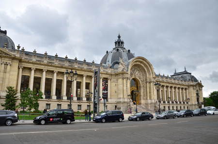 museum visit: Paris, France - May 14, 2015: Tourist visit Great Palace(Grand Palais). Great Palace is a large historic site, exhibition hall and museum complex located at the Champs-Élysées.