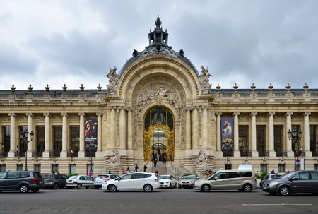 exhibition complex: Paris, France - May 14, 2015: Tourist visit Great Palace(Grand Palais). Great Palace is a large historic site, exhibition hall and museum complex located at the Champs-Élysées.