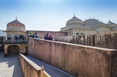jagmandir: Jaipur, India - December 29, 2014: Tourists visit Amber Fort in Jaipur, Rajasthan, India on December 29, 2014. The Fort was built by Raja Man Singh I.