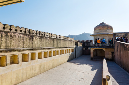 amber fort: Jaipur, India - December 29, 2014: Tourists visit Amber Fort in Jaipur, Rajasthan, India on December 29, 2014. The Fort was built by Raja Man Singh I.