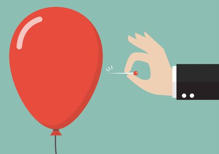 Hand pushing needle to pop the balloon. Business concept