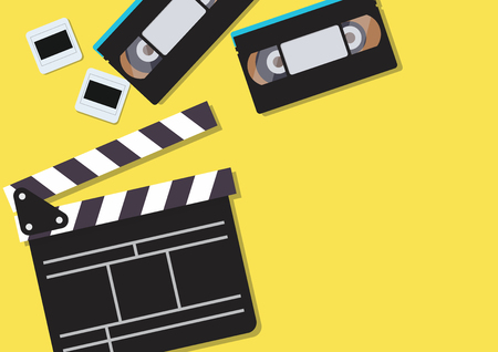 Movie clapper and video cassette tapes on yellow background. Vector illustration