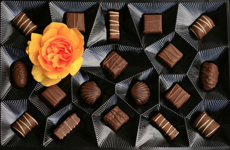 Chocolate box with a yellow rose Stock Photo