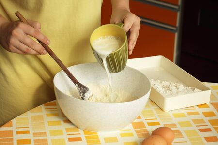 Woman preparing dough for pancakes Stock Photo - 7417102